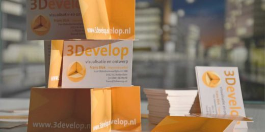 Card house constructed with the use of 3Develop business cards, with the firm's Dudok visualisation in the background