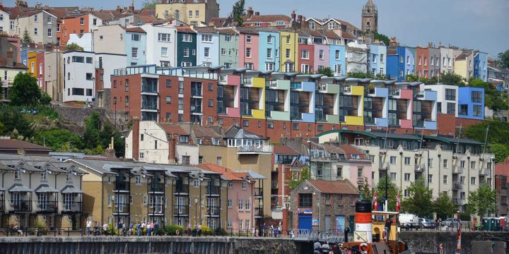 Photo of the multi-colored and rather varied architecture of Bristol, England, with the Floating Harbour in the foreground