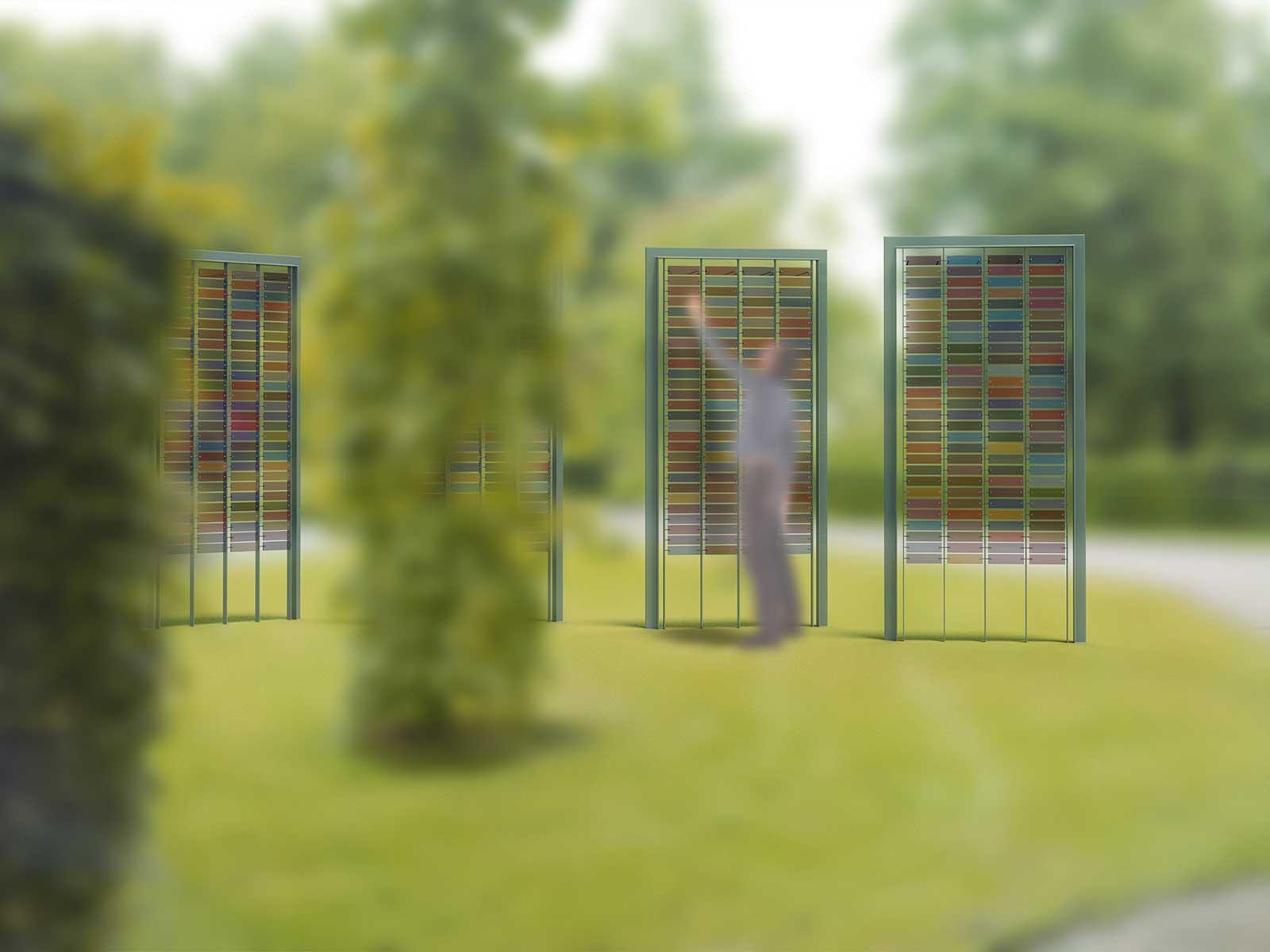 Denkend Aan - Paneelmonument voor begraafplaatsen, ontworpen door Dirry de Bruin, met glaspaneeltjes in veertien verschillende kleuren