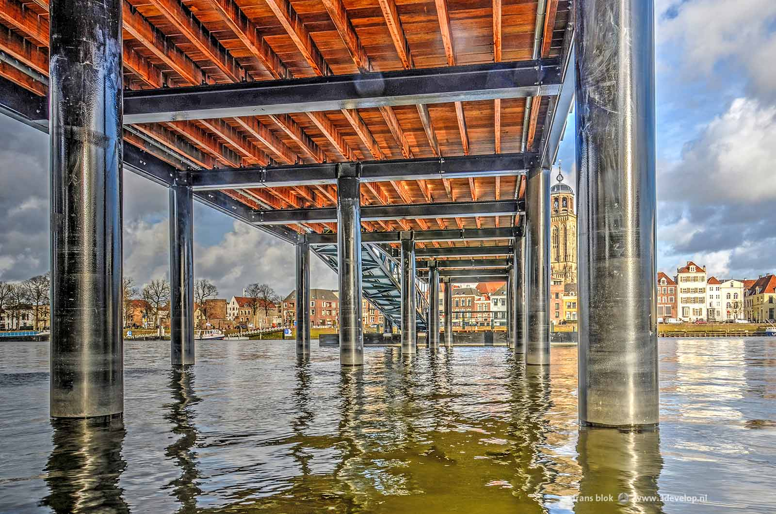 Looking under the new jetty/pontoonbridge at the Worp in Deventer with in the background the skyline of the city with Saint Lebuinus Church