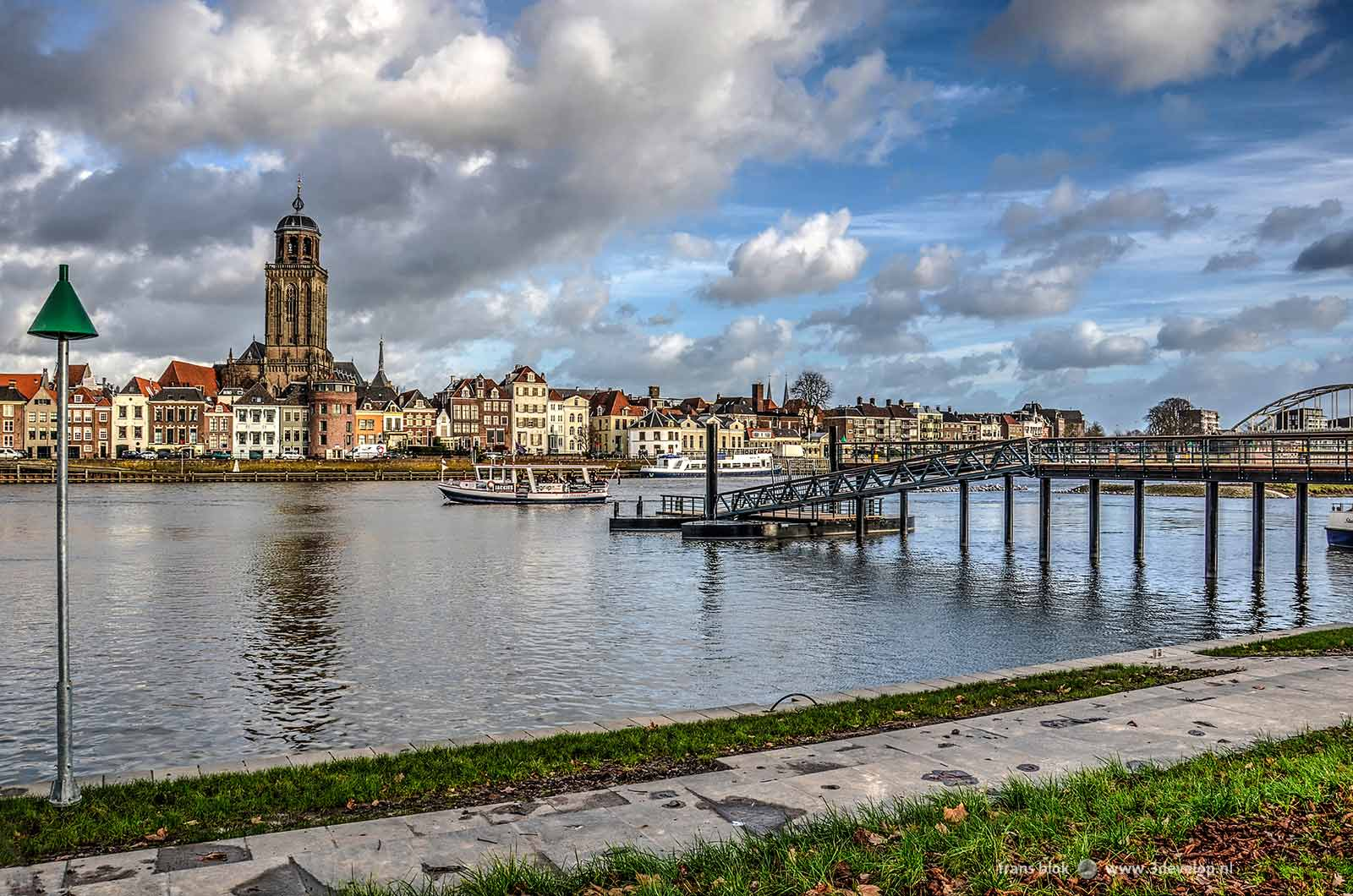 The skyline of Deventer with Saint Lebuinus church, the ferryboat and the new pontoon bridge seen from the Worp near the IJsselhotel