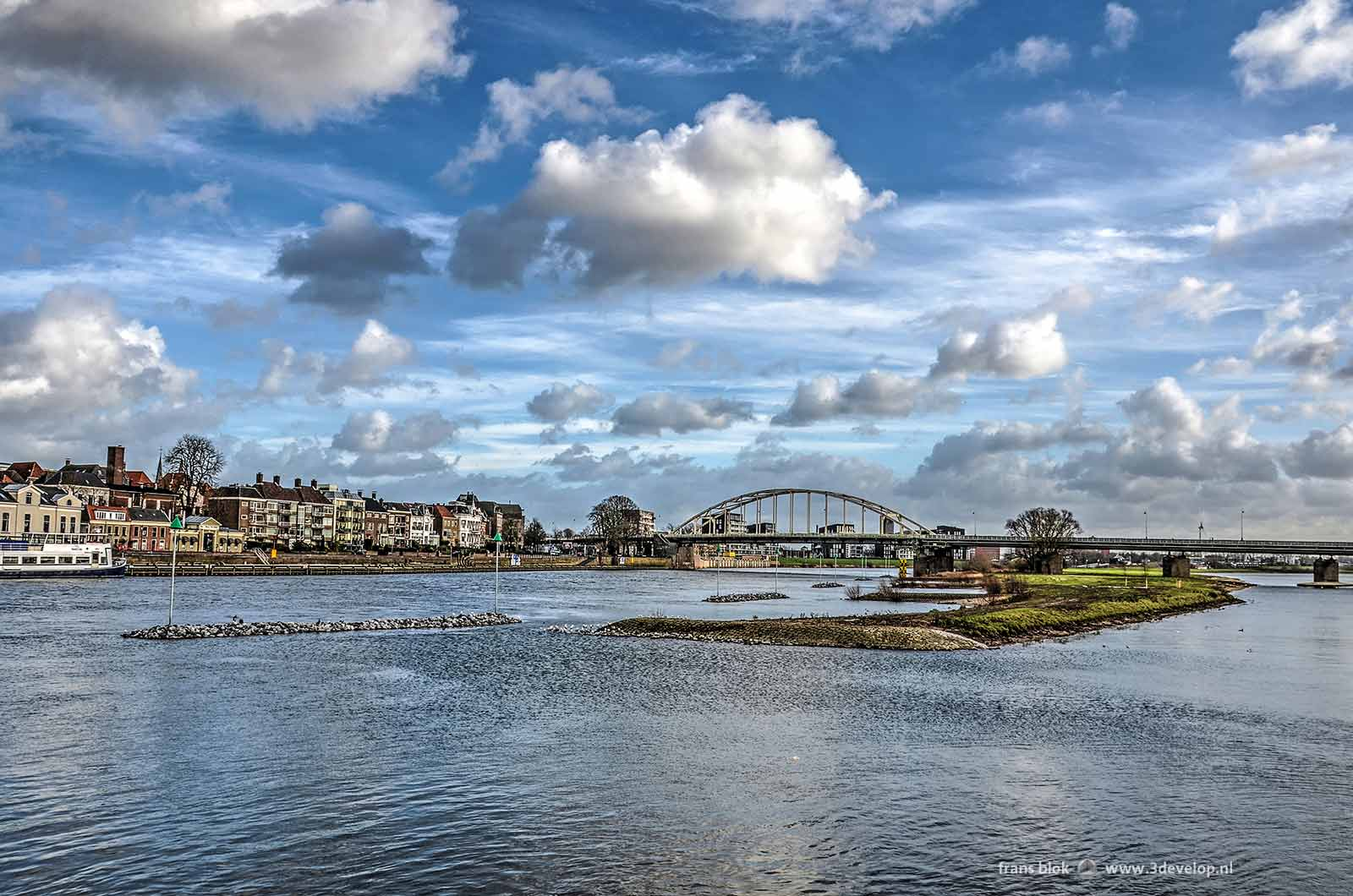 View from the pontoon bridge in Deventer with wilhelmina Bridge and the peninsula between the river IJssel and the new channel