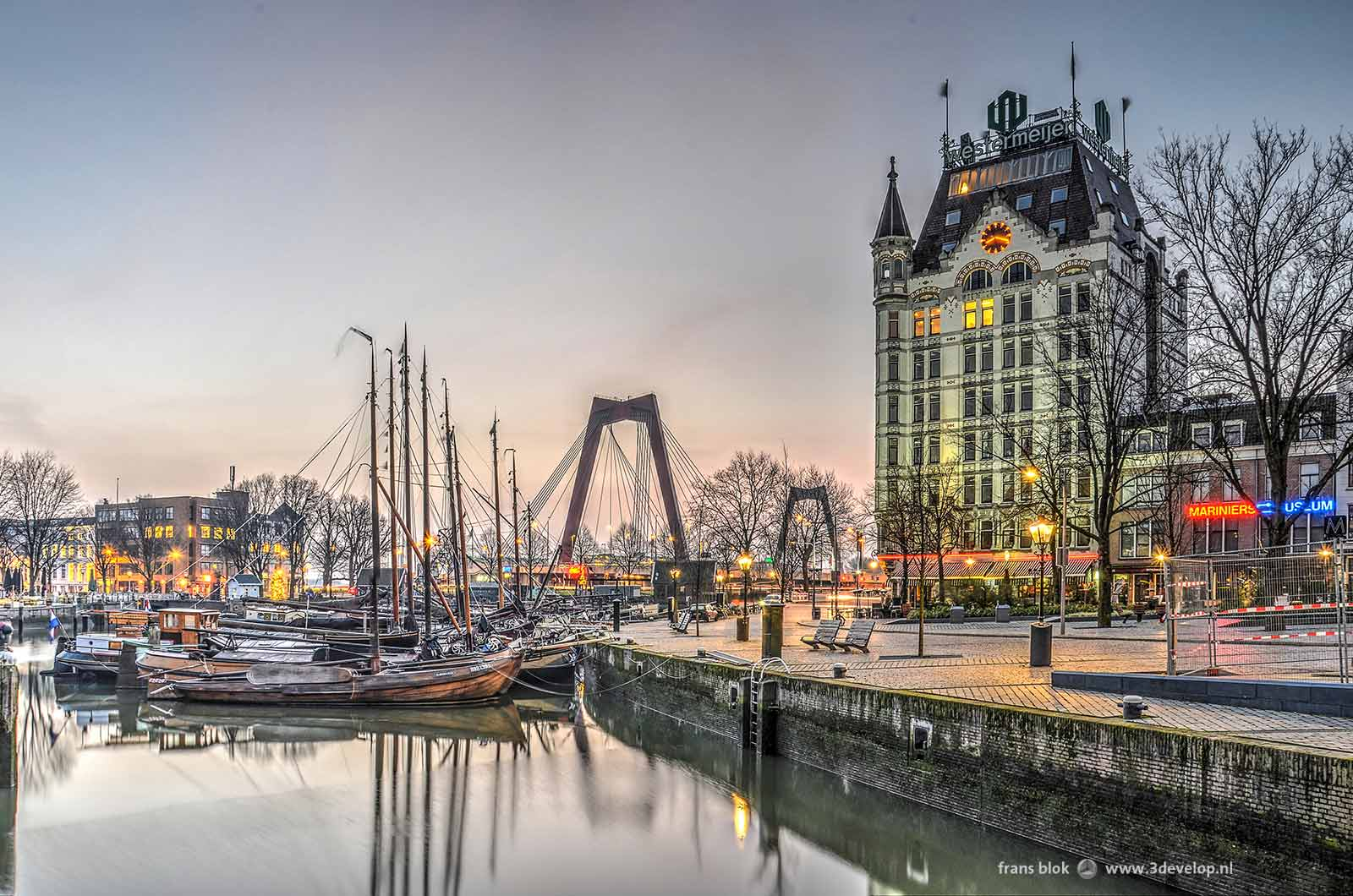 Sunrise on an almost cloudless day in Rotterdam, with Willems Bridge, the White House and the Old Harbour