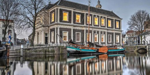 Final version of the HDR photo of the Corn Exchange in Schiedam, with a historic ship in the canal, after editing in Photomatix and Photoshop