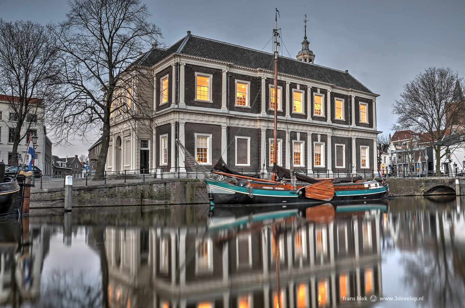 Image of the Corn Exchange/Library in Schiedam, with a historic vessel in the water of the canal, after editing in Photomatix Pro