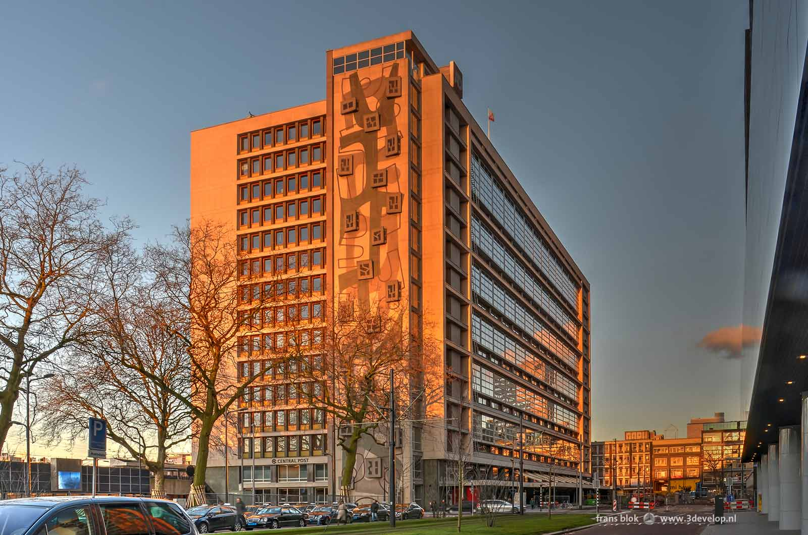 The former Railway Station Post Office, nowadays Central Post, on Delftsestraat in Rotterdam, photographed during the golden hour