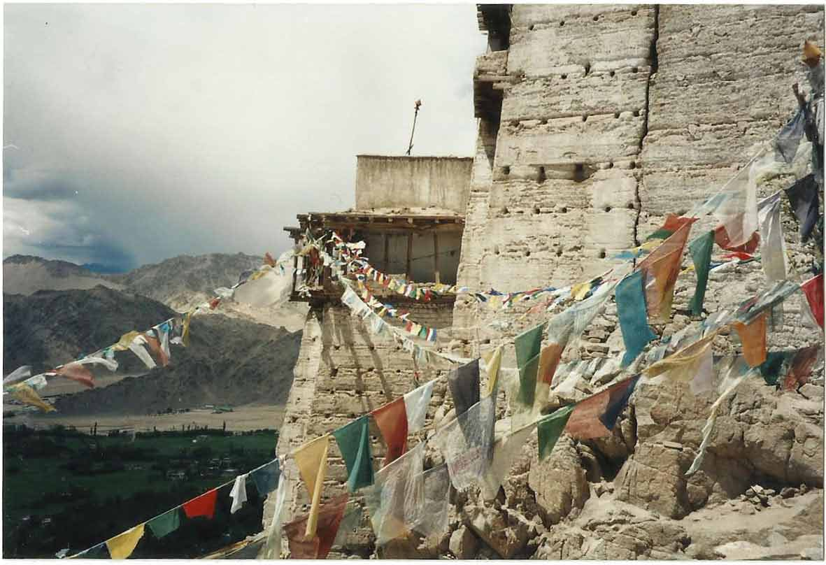 Photo of a monastery with prayer flags made with a Pentax analogue camera in the 1990's