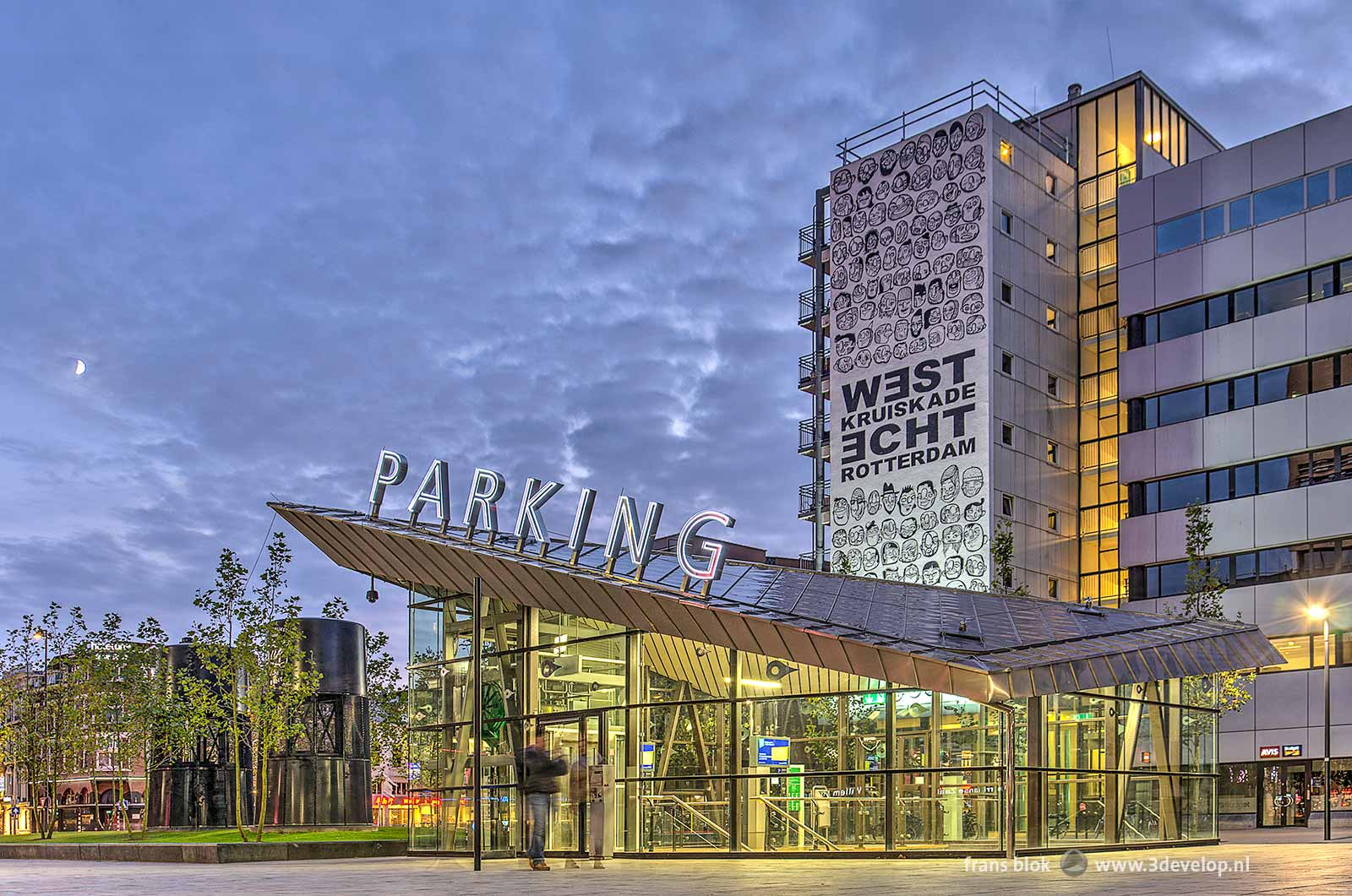 The entrance to the parking garage at the Kruisplein in Rotterdam, photographed around sunset with in the sky the Moon in its First Quarter