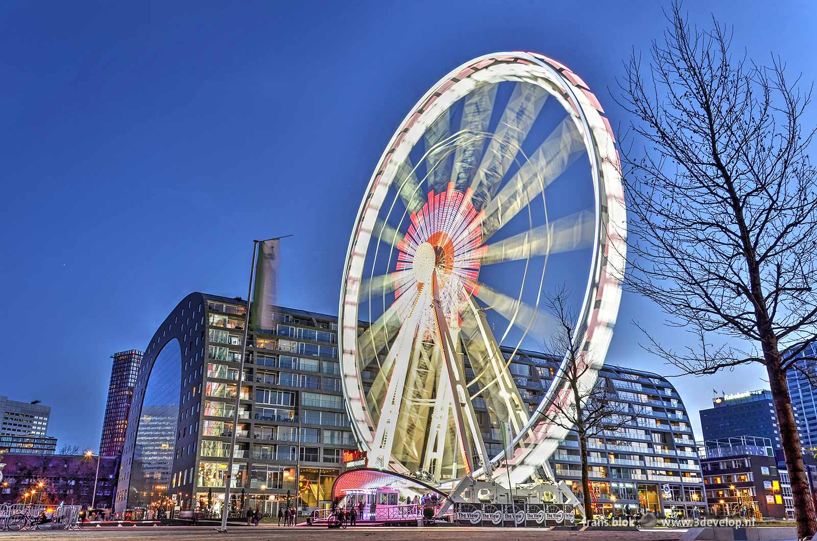 Ferriw Wheel The View, a temporary attraction on Binnenrotte square in downtwon Rotterdam with the famous Markthal in the background