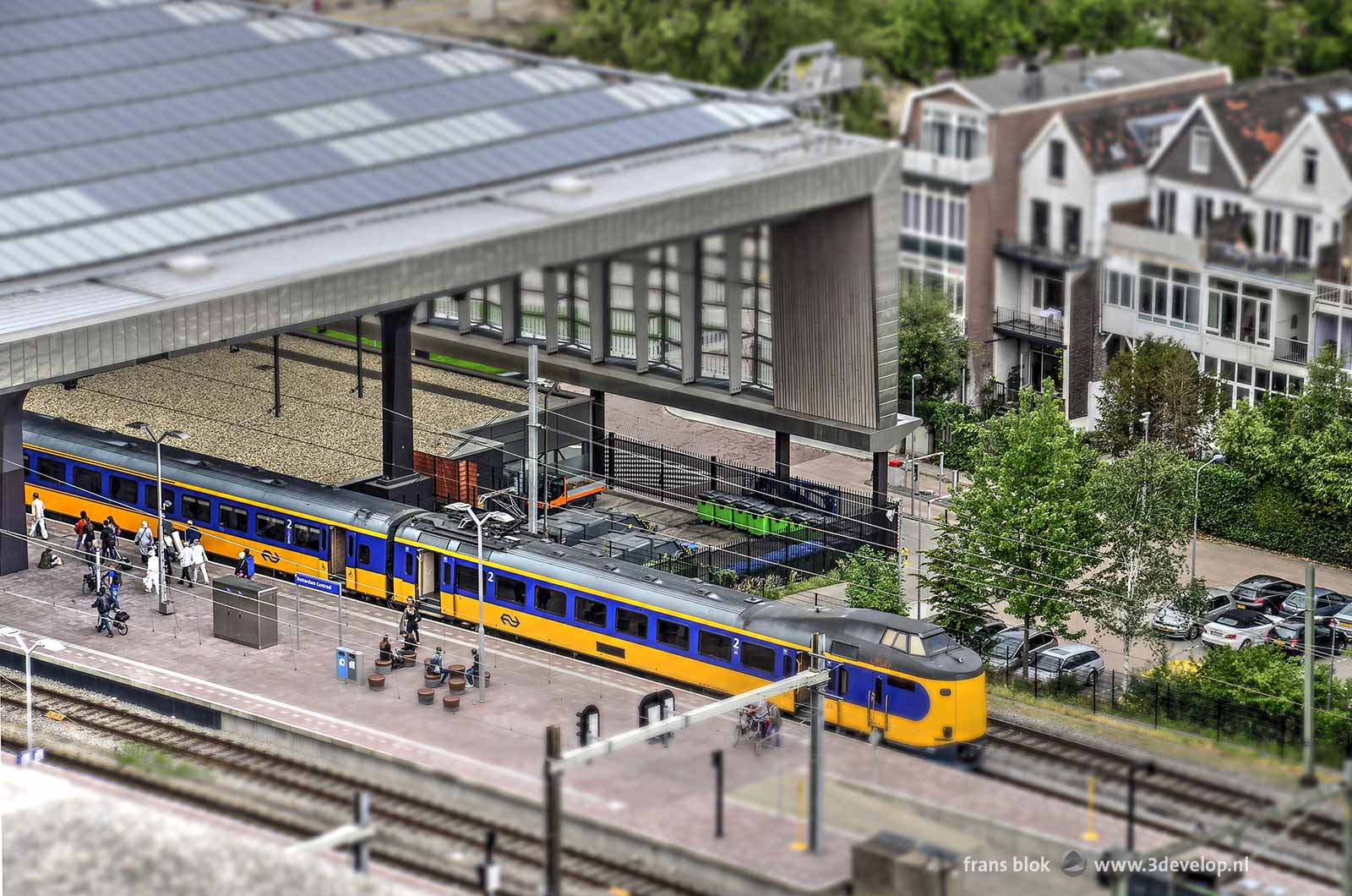 The Miniworld or Madurodam effect on a photo of Rotterdam Central Station featuring a yellow bleu Dutch Railways train