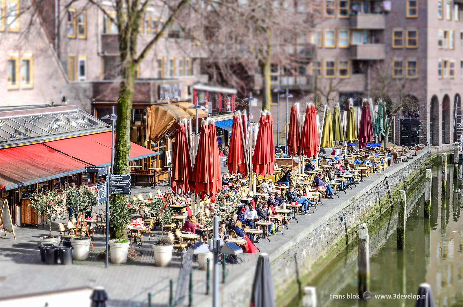 The Miniworld or Madurodam effect on a photo of outdoor cafes at the Old Harbor in Rotterdam