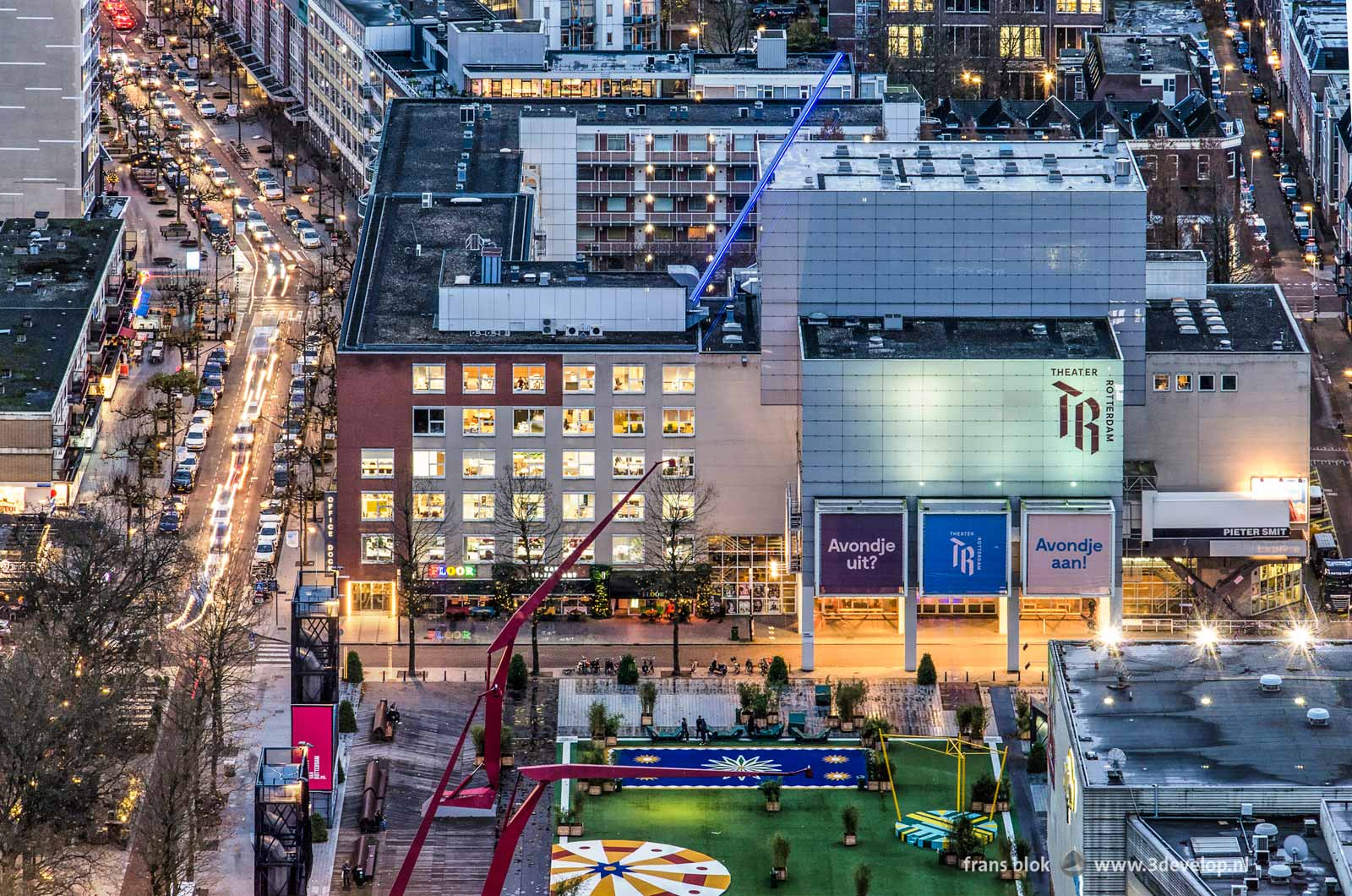 Evening photo of Rotterdamse Schouwburg, Karel Doormanstraat and Schouwburgplein, seen from the Delftse Poort building