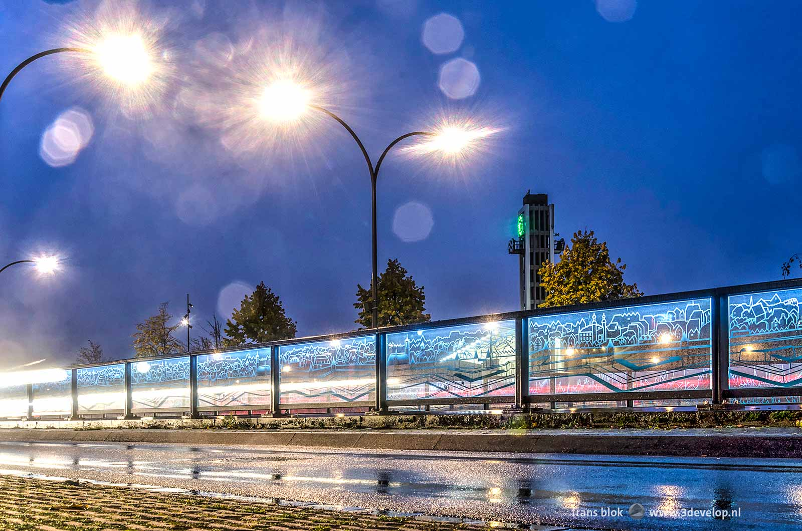 Photo of the glas panels on Koninginneplein in Venlo, The Netherlands, made on a rainy day during the blue hour.