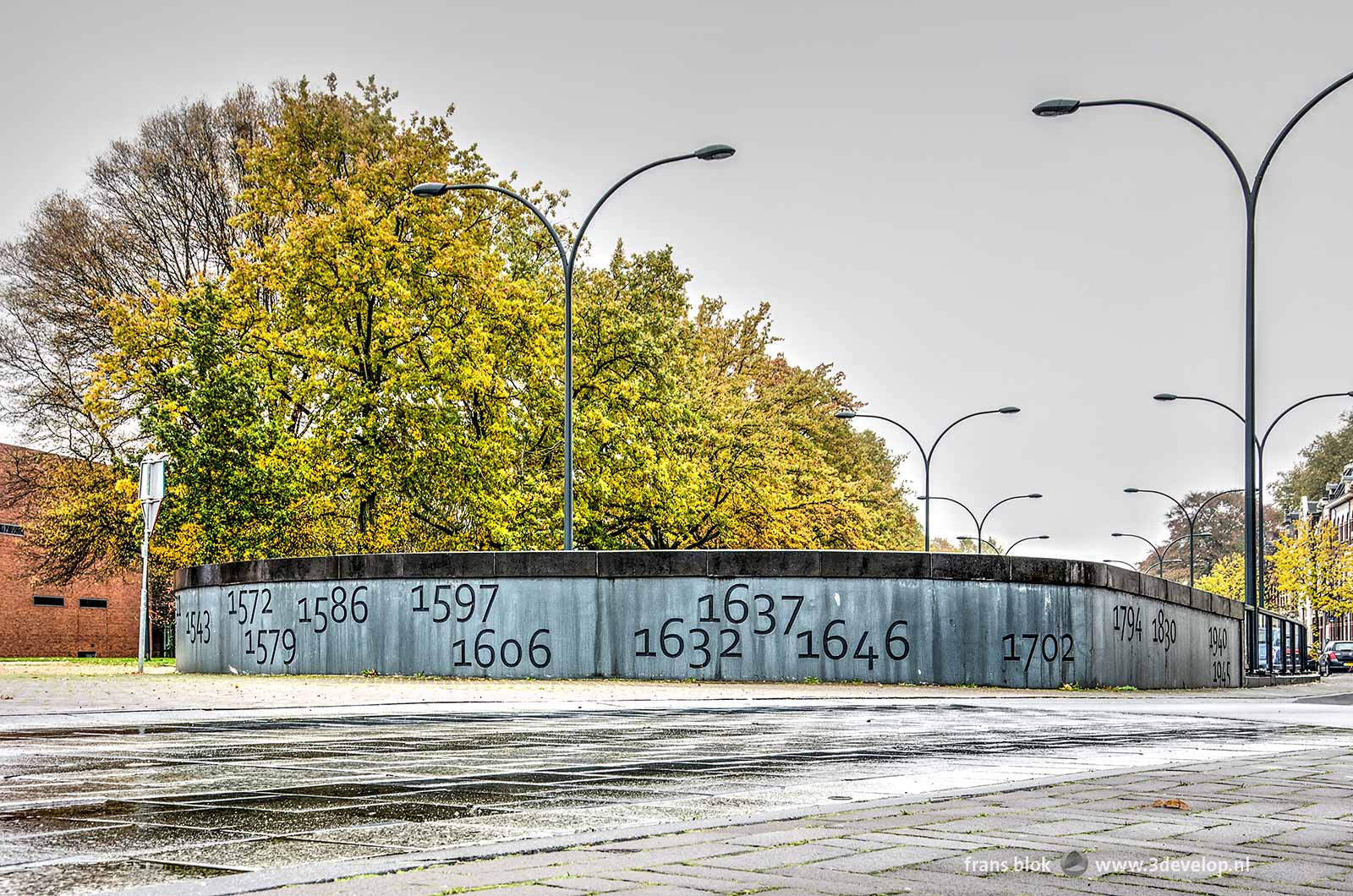 Concrete parapet on Koninginneplein in Venlo, The Netherlands with the years of battles from the city's history