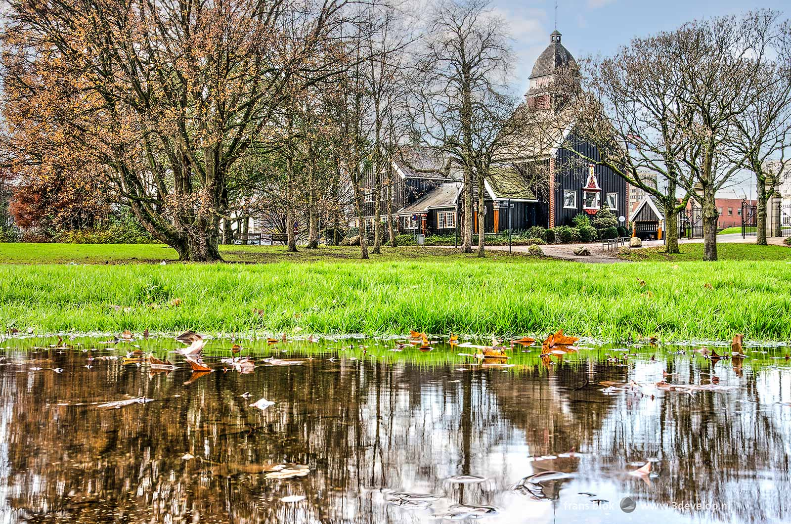 The Park in Rotterdam near the Norwegian Seaman's Church at the end of autumn, with large puddles and almost bare trees