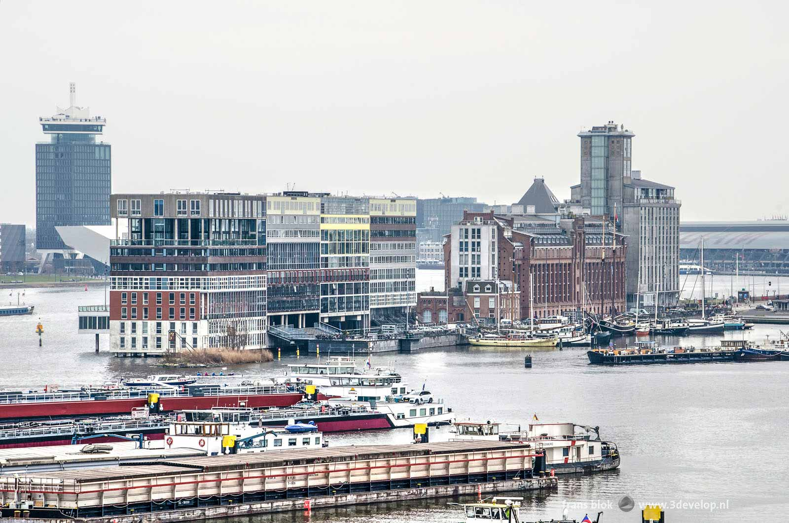View from REM island towards Houthavens, Silodam, the A'dam tower and the Central Station in Amsterdam