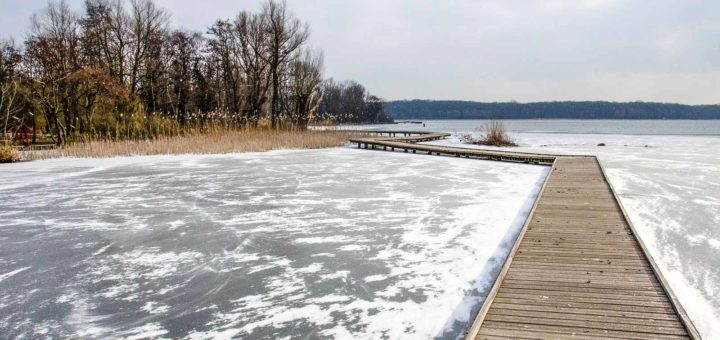 Wooden walkways across the frozen and snow-covered Lake Kralingen in Rotterdam