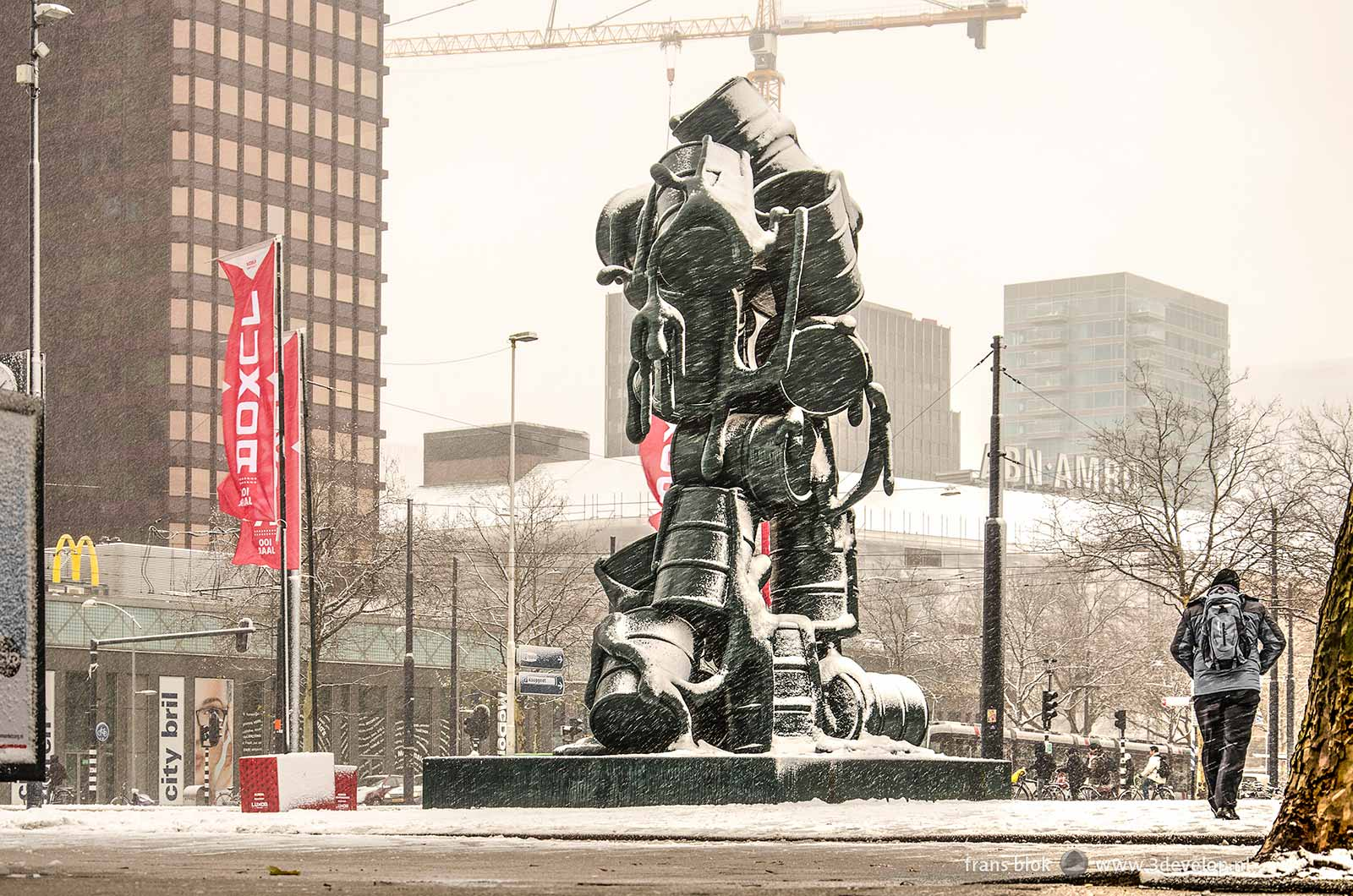 Churchill Square in Rotterdam with the Cascade sculpture by Joep van Lieshout during a snowstorm in december 2017