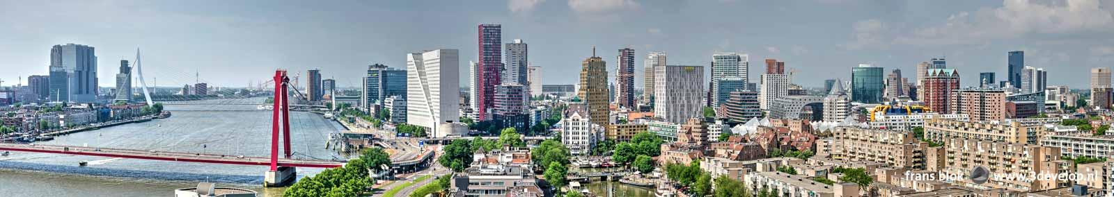 De skyline van Rotterdam gezien vanaf studentenflat de Hoge Wiek tijdens de Dakendagen 2018, met onder andere de Rotterdam, de Erasmusbrug, de Willemsbrug, het Witte Huis en de Markthal.