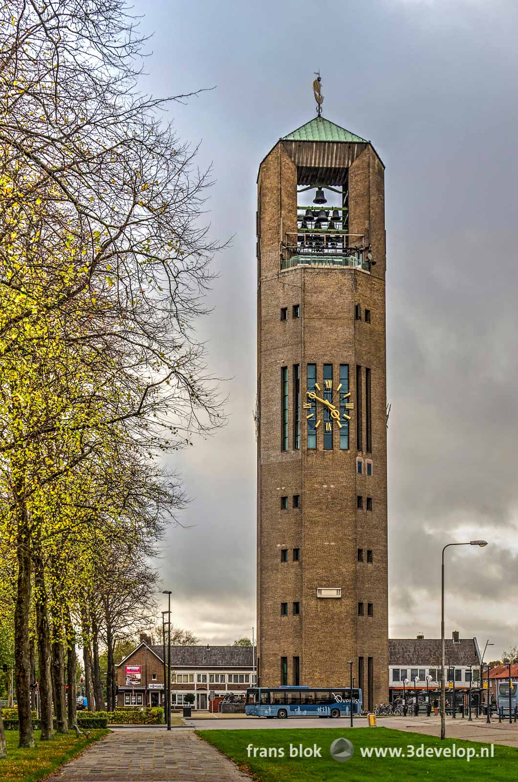 National heritage the Poldertower, with bells and clock, at the busstation in Emmeloord in the North East Polder in the Netherlands