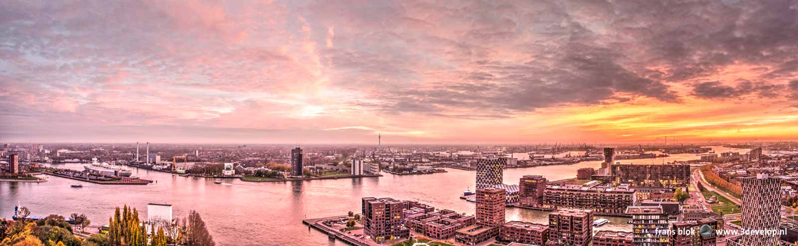 Panoramic image with a spectacular and dramatic sky at sunset over Lloydkwartier, Nieuwe Maas river, Charlois and Waalhaven in Rotterdam, The Netherlands