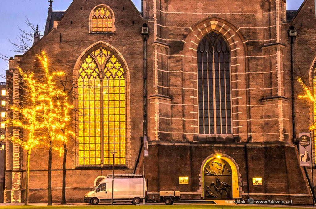 Photograph taken in the early morning of Saint Lawrence Church in Rotterdam, with a disfiguring white van parked in front of it