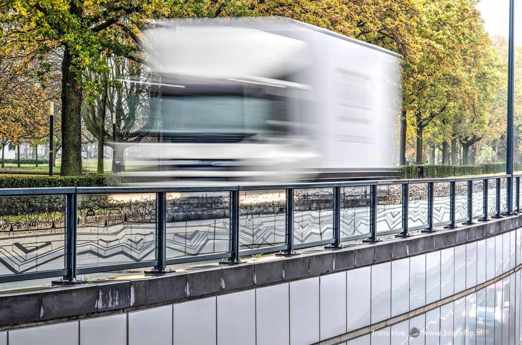 White van passing with high speed next to the underpass at Koninginneplein in Venlo, The Netherlands