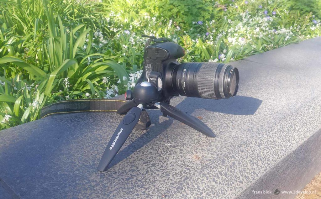 Manfrotto Pixi Evo mini tripod with a Nikon d5100 camera with 300mm telephoto lens mounted on it