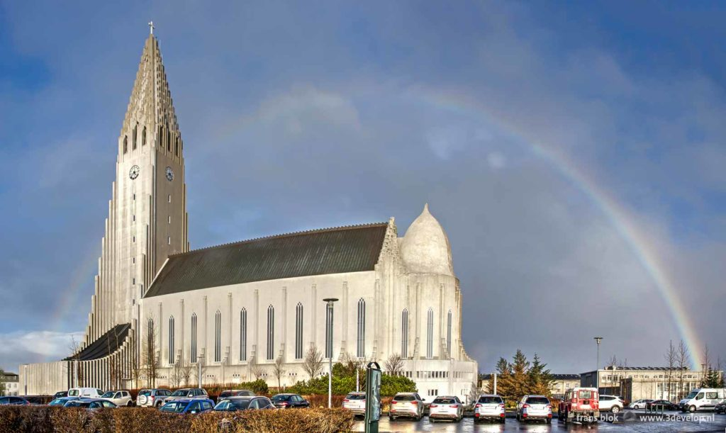 A rainbow behind Hallgrimskirkja, the iconic church in downtown Reykjavik, Iceland