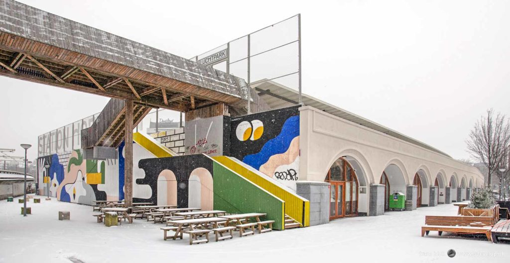 Colorful street art in a white world at the former Hofplein station in Rotterdam on a cold day in winter
