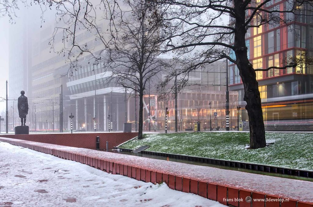 Westersingel in Rotterdam with the Calypso building, De Doelen concert hall and war monument on a wintery morning at dawn
