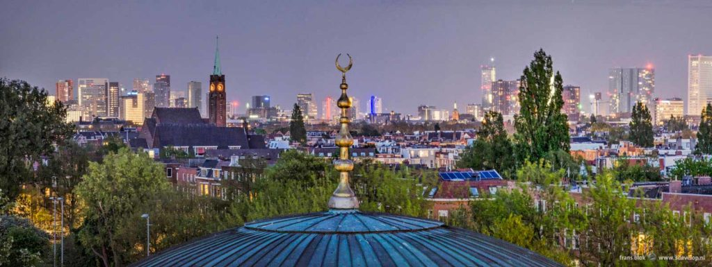The Rotterdam skyline during the blue hour with in the foreground the dome of the Mevlana mosque