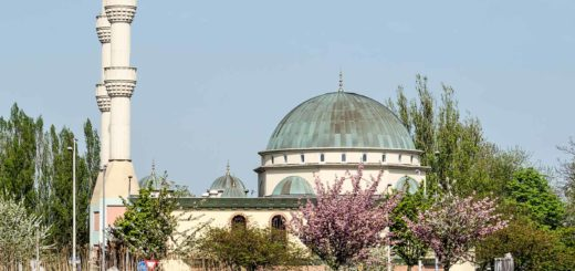 The Mevlana mosque in Rotterdam in springtime with the Schie river in the foreground