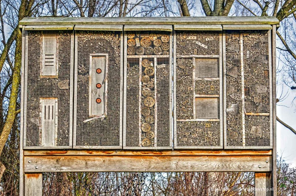 Bee hotel, spelling the word HOTEL, near Spijkernisser bridge in Hoogvliet, The Netherlands