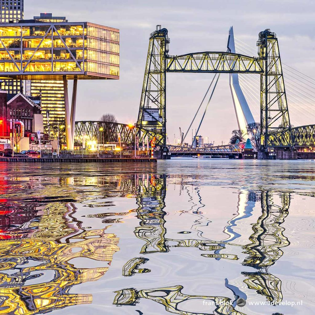 Digitally generated water reflection of railway bridge De Hef, Erasmusbridge and the Unilever building in Rotterdam, The Netherlands in the river Nieuwe Maas