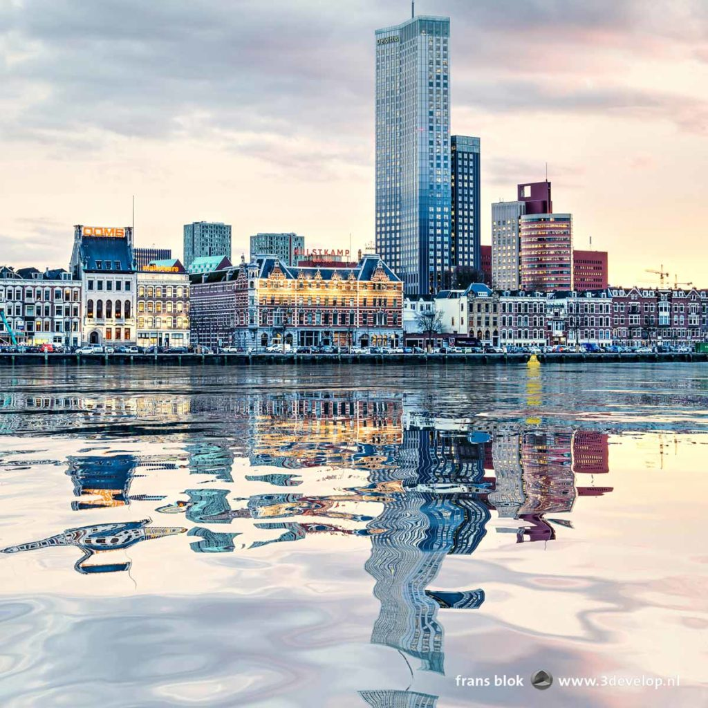 A digital water reflection of Noordereiland and Kop van Zuid skyline in the river Nieuwe Maas in Rotterdam, The Netherlands