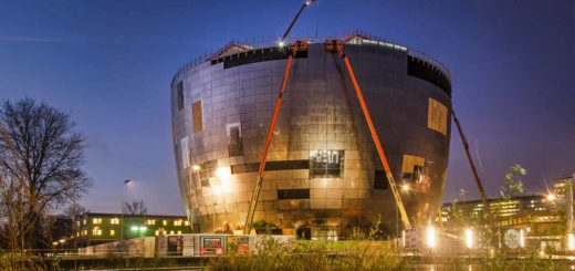 The shining pot of the Boymans museum collection building under construction in Museum Park in Rotterdam during the blue hour on a morning the the winter of 2020