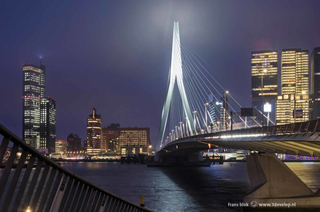 Erasmus bridge, the southbank and the Nieuwe Maas river in Rotterdam in the blue hour before sunrise
