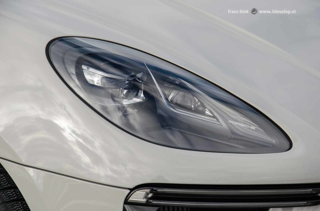 Beautifully designed headlights of a Porsche Macan Turbo