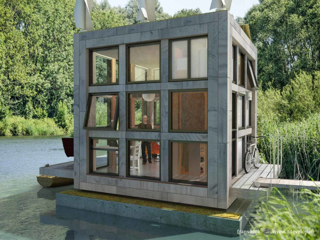 Blok's little Block, a tiny houseboat in a green environment with trees, shrubs, water and reeds