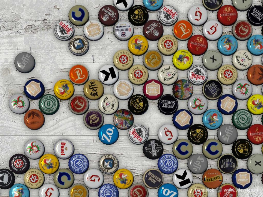 Detail of a world map made of beer bottle caps on a white wooden floor, showing Europe and adjacent regions