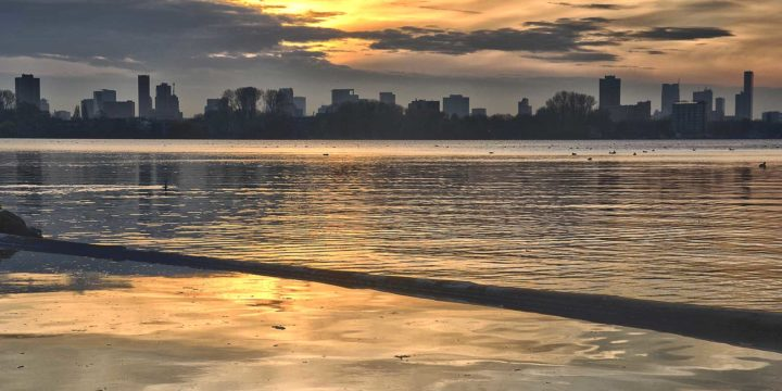 Photorealistic HDR image of the sunset over the Rotterdam skyline and Lake Kralingen