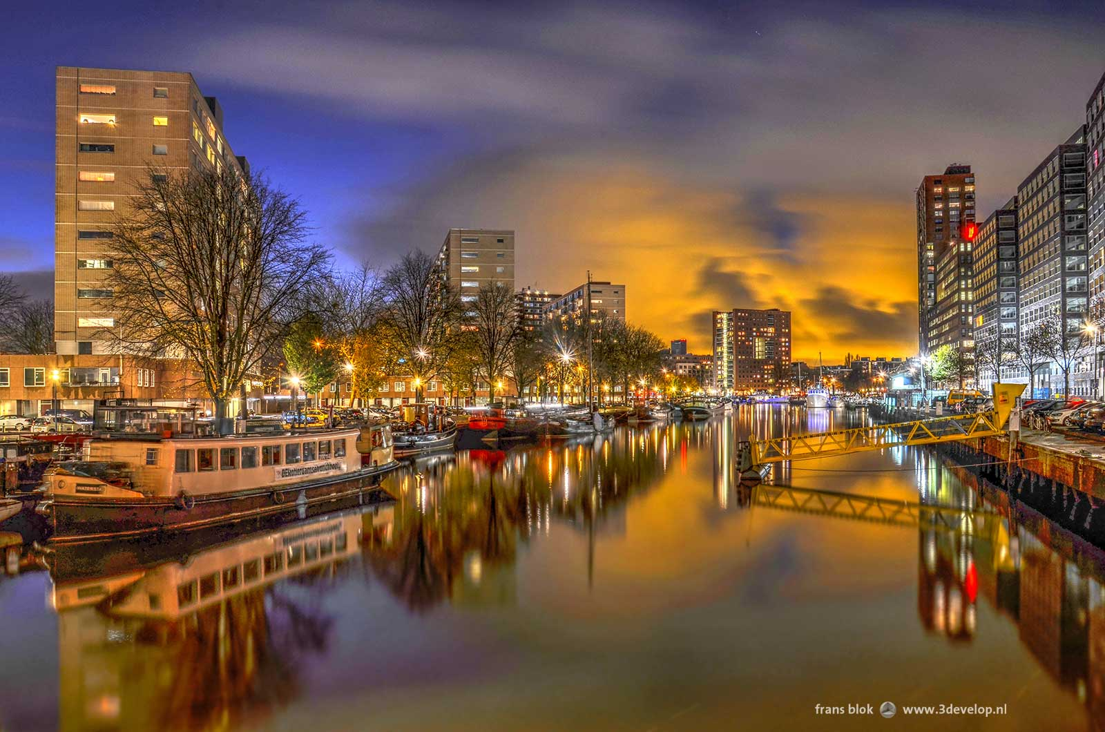 Magic light after sunset above historic harbour Boerengat in Rotterdam