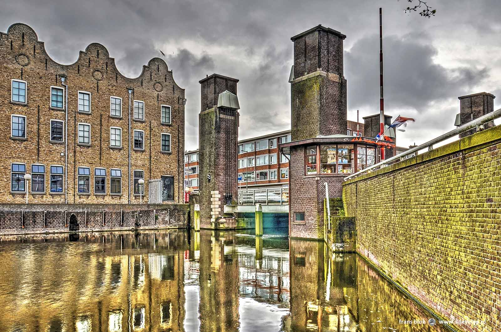 The New Harbour in Schiedam, with historic warehouses and the towers and the bridge keeper's cabin of the Orange Bridge