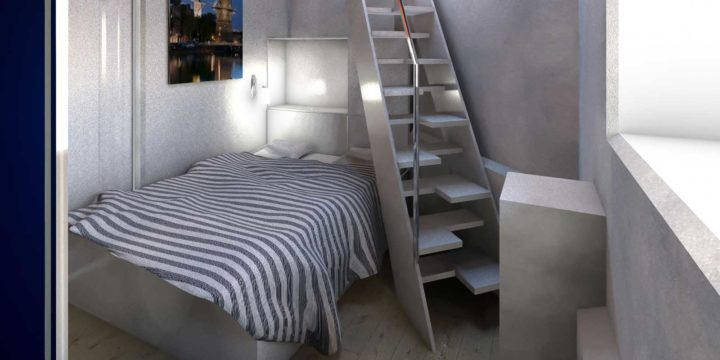 Interior picture of the basement of the Orange Bridge after adaptation to a hotel suite, with double bed and ship stairs.