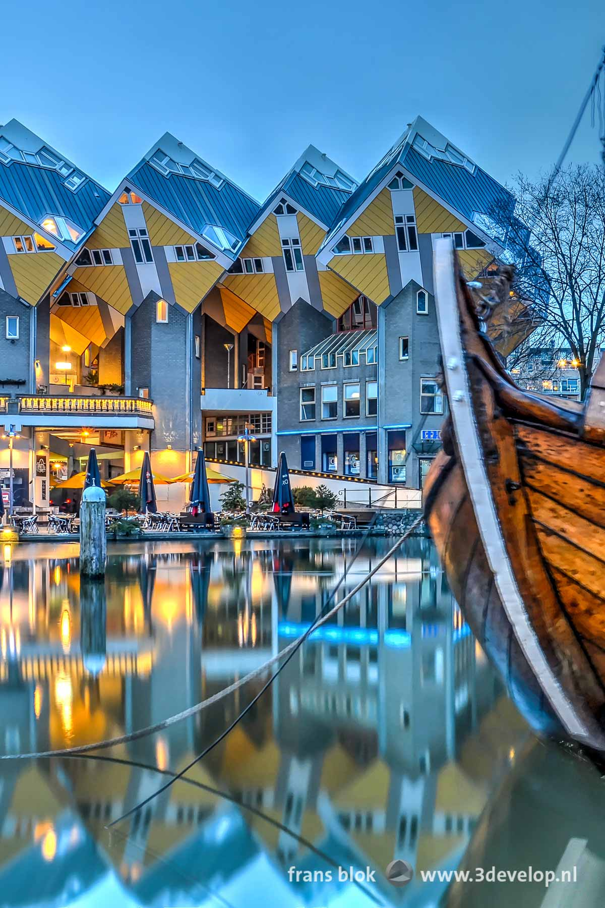 Popular on Pinterest: a photo made at dusk of the Cube houses reflecting in the Old Harbour in Rotterdam