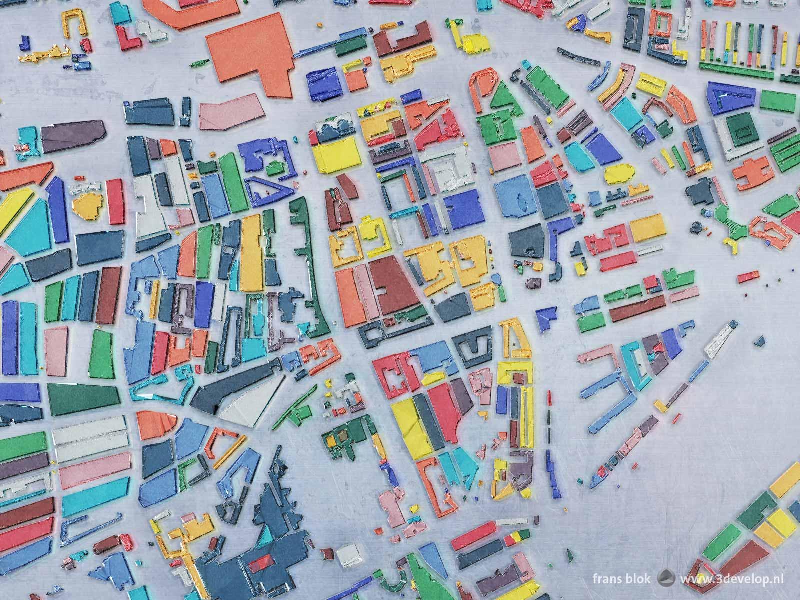 De Rotterdamse biinnenstad tussen Centraal Station en Nieuwe Maas en tussen 'Claese de Vrieselaan en Mariniersweg; fragment van een kaart van Rotterdam met alle bouwblokken uitgevoerd als glas in vijftien kleuren