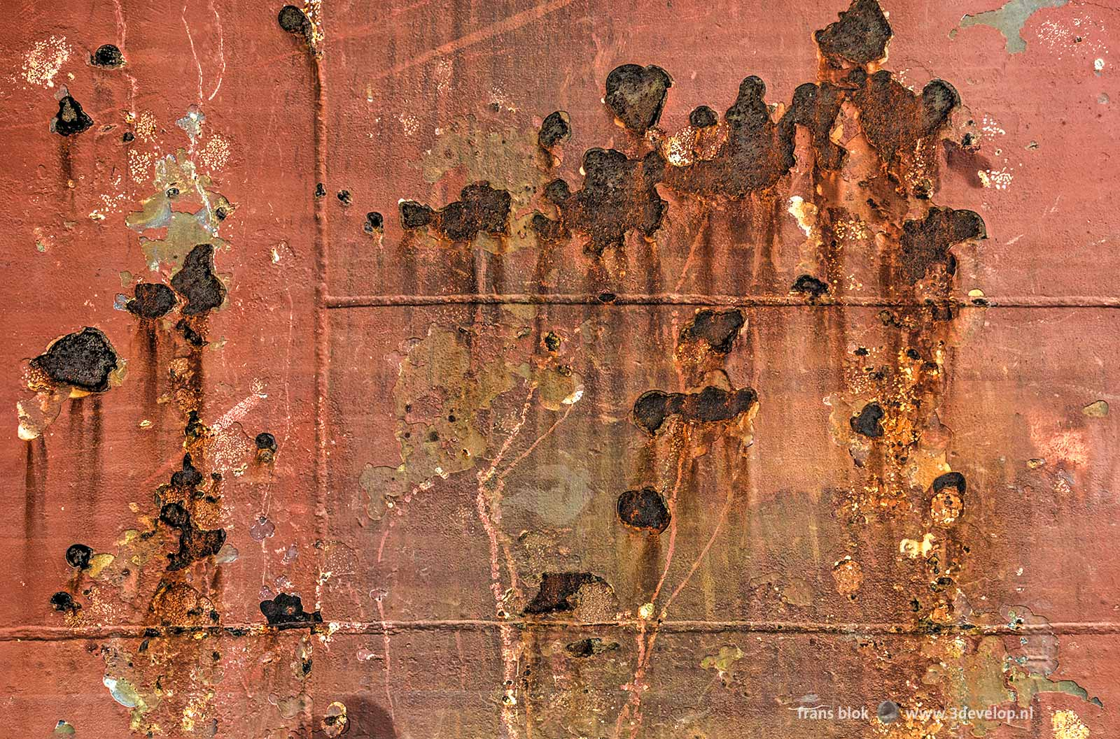 Close-up of the hull of a ship with rust and welding joints, moored at Park Quay in Rotterdam
