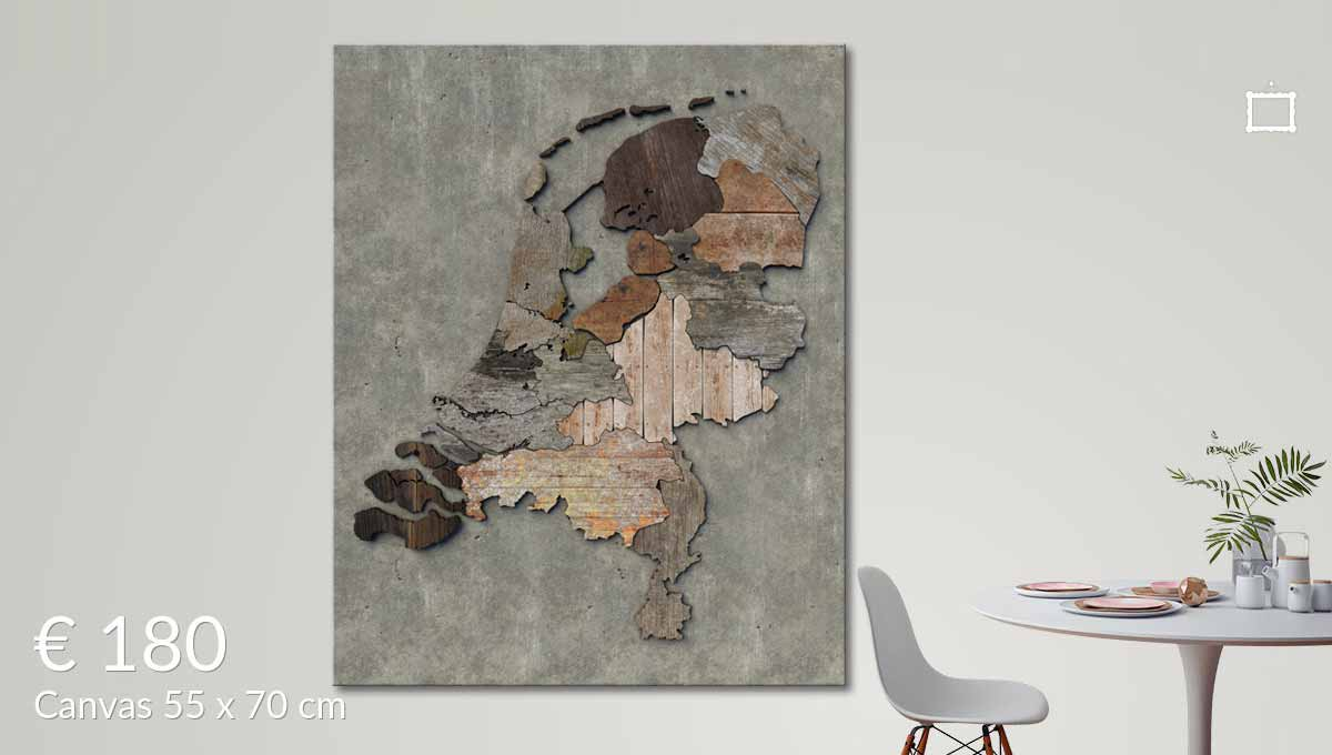 A canvasprint of the scrapwood map of the Netherlands, on the wall in a living room with a table and a chair in the foreground