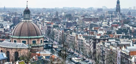 Aerial view of the old center of Amsterdam including the Singel canal, the dome of the Koepelkerk and the tower of the Westerkerk